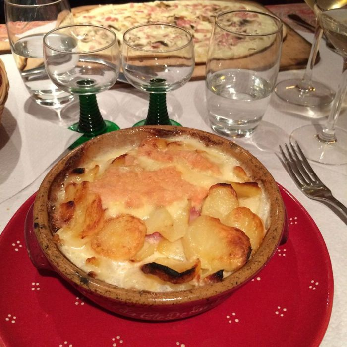 my tartiflette with mom's tarte flambee in the background