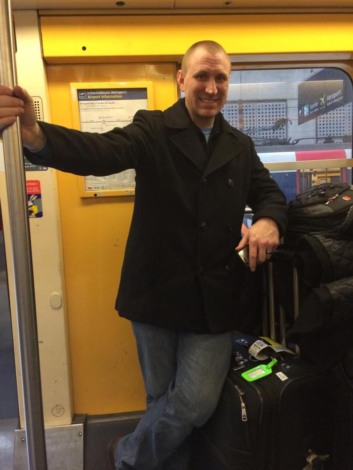 Josh with our luggage on the RER train