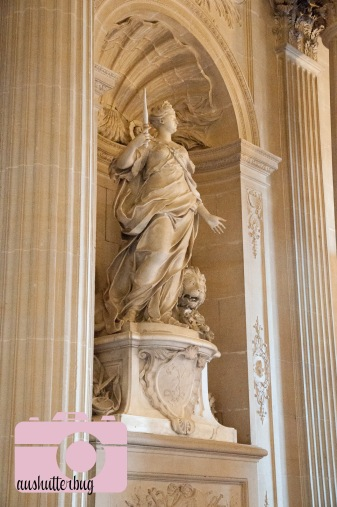 statue over the grand staircase