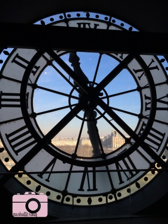 looking out from one of the clock faces of the Musee d'Orsay